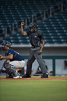 Home plate umpire Demetrius Hicks calls a strike during an Arizona League game between the AZL Cubs 1 and the AZL Brewers at Sloan Park on June 29, 2018 in Mesa, Arizona. The AZL Cubs 1 defeated the AZL Brewers 7-1. (Zachary Lucy/Four Seam Images)