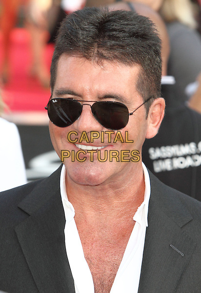 Simon Cowell<br /> attended the &quot;One Direction: This is Us 3D&quot; world film premiere, Empire cinema, Leicester Square, London, England.<br /> August 20th, 2013<br /> headshot portrait black suit jacket white shirt sunglasses shades ray bans<br /> CAP/ROS<br /> &copy;Steve Ross/Capital Pictures