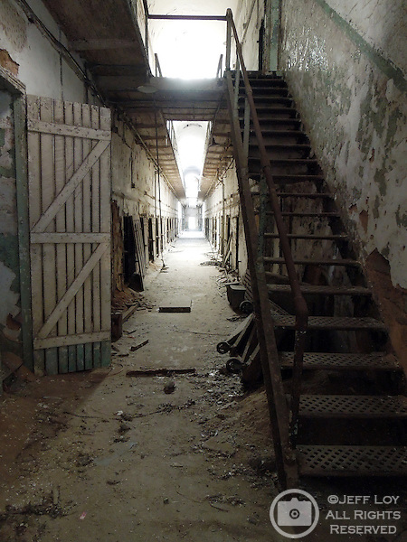 A hallway at Eastern State Penitentiary in Philadelphia, Pennsylvania. The site is considered to be the world's first true penitentiary and when it opened in 1829, inmates were kept in complete solitary confinement. The penitentiary was closed in 1971 and is now a historical site and tourist attraction.