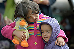 Six-year old Miriam, a refugee from Afghanistan, holds her stuffed toy duck as she embraces her little brother inside a refugee processing center in the Serbian village of Presevo, not far from the Macedonian border. Hundreds of thousands of refugees and migrants--including many children--have flowed through Serbia in 2015, on their way from Syria, Iraq and other countries to western Europe. <br /> <br /> Parental consent obtained.