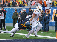 Morgantown, WV - November 18, 2017: Texas Longhorns running back Kyle Porter (21) stiffs arm West Virginia Mountaineers safety Kenny Robinson (2) to score a touchdown during game between Texas and WVU at  Mountaineer Field at Milan Puskar Stadium in Morgantown, WV.  (Photo by Elliott Brown/Media Images International)
