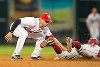 Shortstop Jake Runte #13 of the Houston Cougars tags out Tim Carver #18 of the Arkansas Razorbacks as he tries to steal second base at Minute Maid Park on March 3, 2012 in Houston, Texas.  The Cougars defeated the Razorbacks 4-1.  Brian Westerholt / Four Seam Images