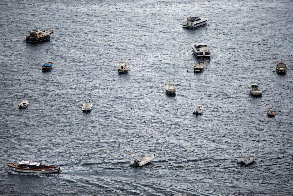 Anchored boats are seen in the harbor on Sunday, Sept. 20, 2015, in Positano, Italy. (Photo by James Brosher)