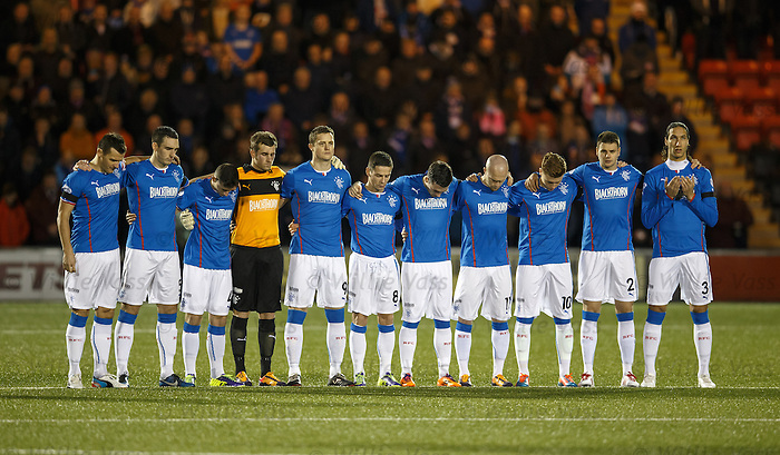 Rangers players during the minutes silence for the 66 victims of the Ibrox disaster