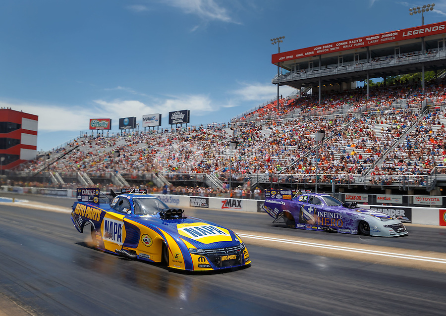 Jun 19, 2016; Bristol, TN, USA; NHRA funny car driver Ron Capps (near) races alongside teammate Jack Beckman during the Thunder Valley Nationals at Bristol Dragway. Mandatory Credit: Mark J. Rebilas-USA TODAY Sports