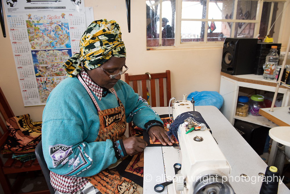 Africa, Swaziland, Malkerns.Nest organization artisan project, partnering with Baobab Batik & local artisans to help market their products to global markets and better sustain their local community. Women making batik.