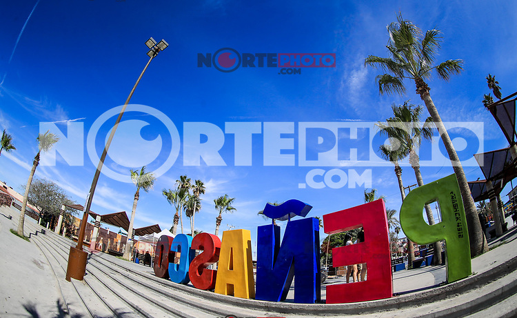 Letters of various colors with the word Penasco in the tourist destination called Puerto Penasco, Sonora, Mexico. laza or malecon of the tourist destination called Puerto Peñasco, Sonora, Mexico. plameras and blue sky. sunny day<br /> (Photo: Luis Gutierrez /NortePhoto.com)<br /> <br /> <br /> Letters of various colors with the word Penasco in the tourist destination called Puerto Peñasco, Sonora, Mexico. laza o malecon del  destino turistico llamado Puerto Peñasco, Sonora, Mexico. plameras y cielo azul. dia soleado<br /> (Photo: Luis Gutierrez /NortePhoto.com)