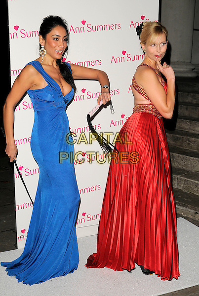 SOFIA HAYAT & ANNEKA SVENSKA.The Ann Summers Enchantment Collection launch party, The Baccarat Room, 1 Marylebone Rd., London, England..December 1st, 2008.anne full length red pleats pleated long maxi silk satin dress gold trim whip hand finger blue spank spanking gesture funny ruched sophia.CAP/CAN.©Can Nguyen/Capital Pictures.