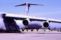 US Air Force Military Cargo Transport Aircraft on Static Display - at Abbotsford International Airshow, BC, British Columbia, Canada - Lockheed C-5 Galaxy Cargo Transporter in foreground, and McDonnell Douglas KC-10 Extender in background