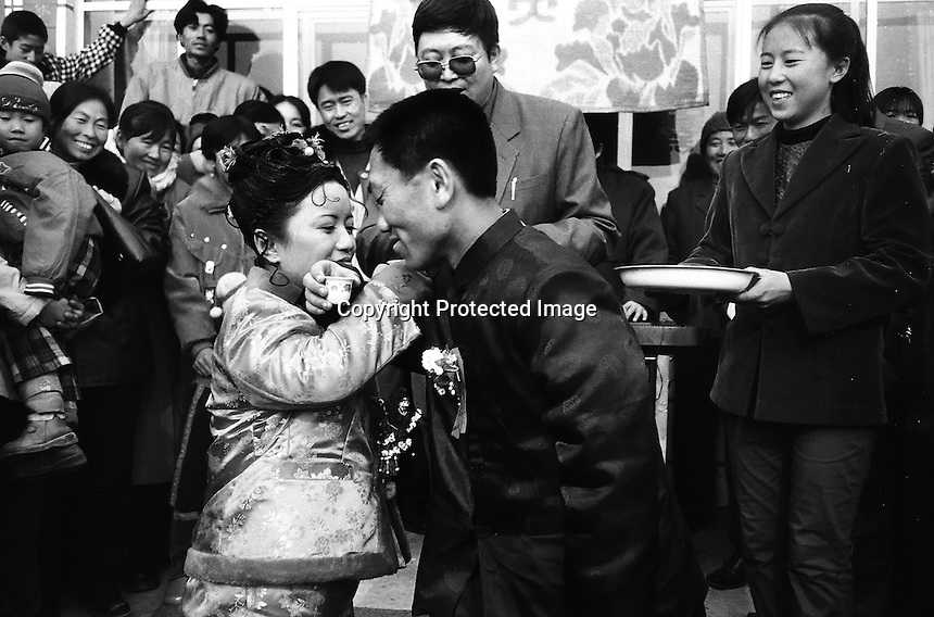 Xian Wang and Wuxi Yue make a toast to everyone at their wedding in the suburb area of Inner Mongolia, China. The handsome couple agreed to get married and became engaged last Valentine's day. The dwarf marriage ceremony attracted the attention of the whole of Zhangfang village who came out to wish the couple happiness and prosperity... XIE TSING SONG /SINOPIX