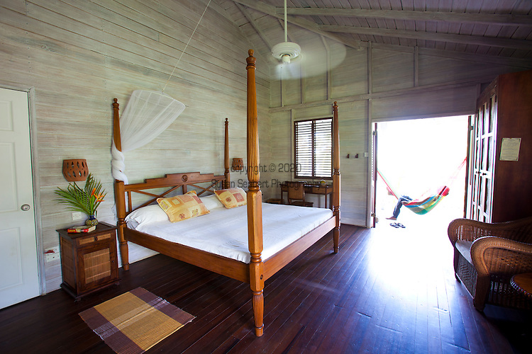 Sea-U Guest House hotel in Bathsheba features lush gardens and some ocean views.  The 7 room hotel offers Bajan dinners by reservation only.  Pictured here is room 7, a spacious room with a shared balcony.