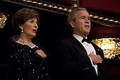 WASHINGTON, DC: U.S. President George Bush and First Lady Laura Bush sing the National Anthem while attending the annual Kennedy Center Honors Gala, Sunday, December 3, 2006, in Washington, DC.  .(Photo by Chris Greenberg/POOL/Bloomberg News)
