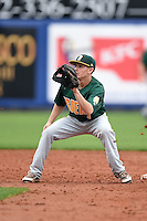 Siena Saints infielder Tyler Martis (1) waits for a throw on a stolen base during the first game of a doubleheader against the Michigan Wolverines on February 27, 2015 at Tradition Field in St. Lucie, Florida.  Michigan defeated Siena 6-2.  (Mike Janes/Four Seam Images)