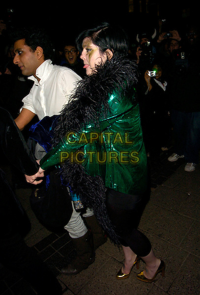 KELLY OSBOURNE.Kate Moss' 34th birthday party, Punk bar & club, London, England..January 16th, 2008.full length gold shoes profile black feather tongue leggings green sequins sequined make-up makeup painting face paint.CAP/CAN.©Can Nguyen/Capital Pictures