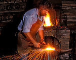The Farrier, Mark Rochon, at his forge.  Specialist in shoeing heavy horses, competition horses.  Model released.