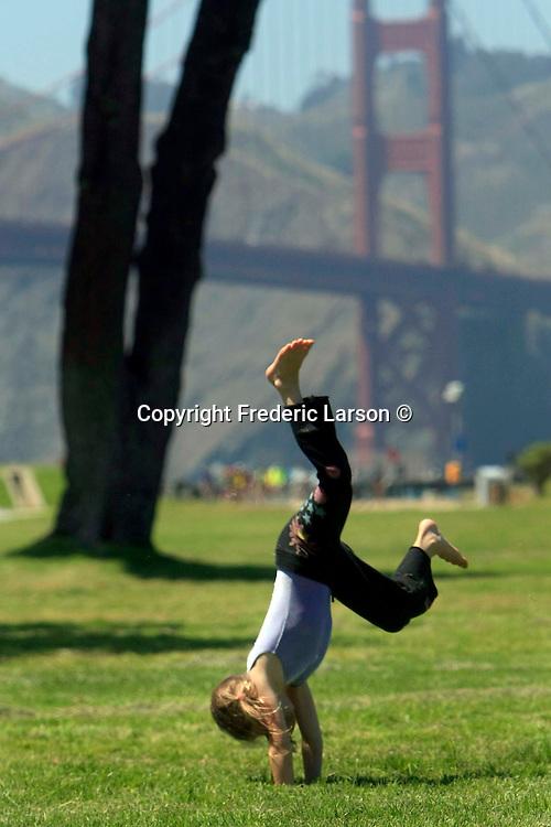 Maezen McHane was doing cart wheels at Crissy Field while at San Francisco Gymnastics Summer Camp.