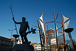 Statue of Neptune and modern sculpture in Broad Quay, Bristol city centre