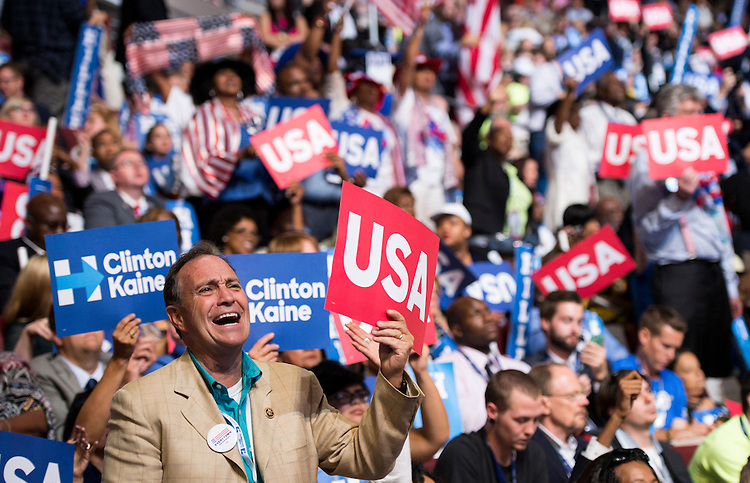 UNITED STATES - JULY 28: Rep. Ed Perlmutter, D-Colo., waves a USA sign as he stands with the Colorado delegation at the Democratic National Convention in Philadelphia on Thursday, July 28, 2016. (Photo By Bill Clark/CQ Roll Call)
