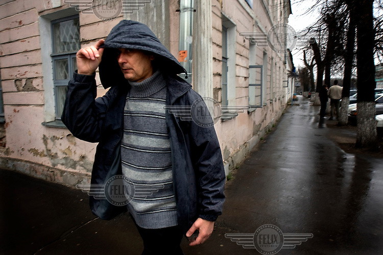 People walk on a delapidated street in the town of Tver.