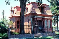 Porterville CA: Pearle Priscilla Zalud House, c. 1875. 1 1/2 story Mansard. 393 N. Hockett on Nat. Reg. Hist. Pl.