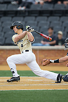 Stuart Fairchild (4) of the Wake Forest Demon Deacons follows through on his swing against the Georgia Tech Yellow Jackets at David F. Couch Ballpark on March 26, 2017 in  Winston-Salem, North Carolina.  The Demon Deacons defeated the Yellow Jackets 8-4.  (Brian Westerholt/Four Seam Images)