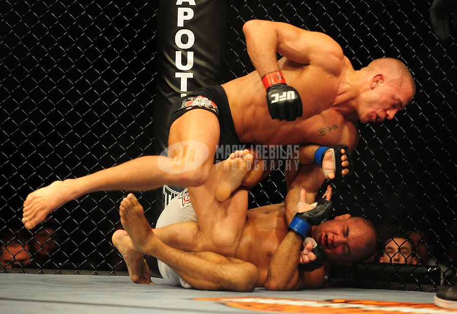 Jan. 31, 2009; Las Vegas, NV, USA; UFC fighter Georges St-Pierre (black trunks) punches B.J. Penn (white trunks) during the welterweight championship in UFC 94 at the MGM Grand Hotel and Casino. St-Pierre defeated Penn with a fourth round TKO. Mandatory Credit: Mark J. Rebilas-