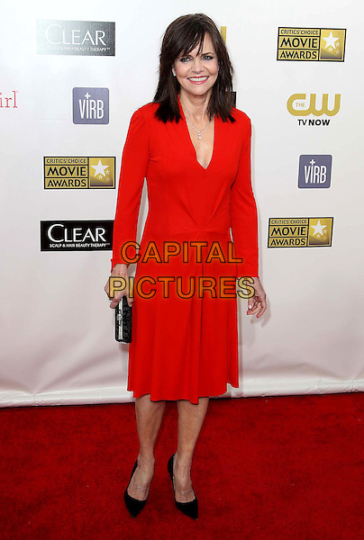 Sally Field .18th Annual Critics' Choice Movie Awards - Arrivals held at Barker Hangar, Santa Monica, California, USA,.10th January 2013.full length red long sleeve dress v-neck black shoes clutch bag .CAP/ADM/KB.©Kevan Brooks/AdMedia/Capital Pictures.