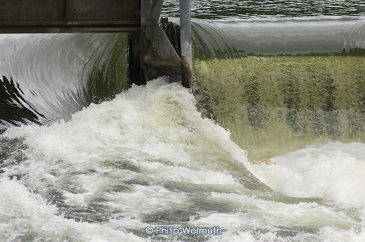 Water flows through a weir on the river Thames at Henley-on-Thames.