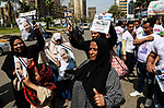 Egyptians hold privately-sponsored posters of incumbent President Abdel Fattah al-Sisi on the the second day of the presidential election at a polling station, in Cairo, Egypt, on March 27, 2018. Egyptians head to the polls in a three-day vote to choose between incumbent Abdel Fattah al-Sisi and candidate Moussa Mostafa Moussa. Photo by Fayed El-Geziry