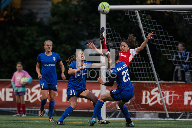 Seattle, WA - Thursday, May 26, 2016: Danielle Van de Donk (21) of Arsenal Ladies FC plays the ball under pressure from Kathryn Bennett (31) of the Seattle Reign FC and midfielder Kiersten Dallstream (25). The Seattle Reign FC of the National Women's Soccer League (NWSL) and the Arsenal Ladies FC of the Women's Super League (FA WSL) played to a 1-1 tie during an international friendly at Memorial Stadium.