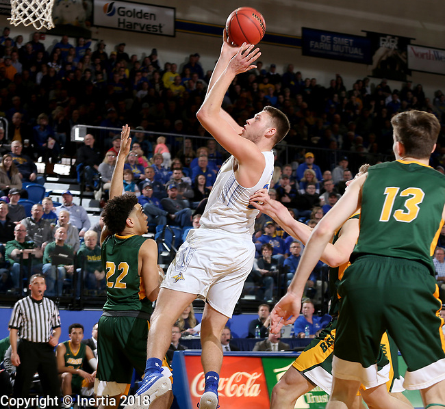 BROOKINGS, SD - FEBRUARY 1: Mike Daum #24 from South Dakota State University drives to the basket against Cameron Hunter #22 from North Dakota State University during their game Thursday at Frost Arena in Brookings. (Photo by Dave Eggen/Inertia)