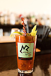 March 22, 2014. Durham, North Carolina.<br />  After race Bloody Mary, with bacon.<br />   To celebrate their upcoming 25th anniversary, MERGE Records hosted a 25k race from Chapel Hill, where the label originated, to their new home in Durham. 693 people race the 15 mile course and celebrated at the after party in the streets.