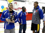 BROOKINGS, SD - SEPTEMBER 23:  South Dakota State University's Zach Zenner, left, along with teammates Reggie Gandy and Cam Jones smile as Zenner was named to the 2014 Allstate AFCA Good Works Team Tuesday afternoon at Hillcrest Elementary School in Brookings. (Photo/Dave Eggen/Inertia)