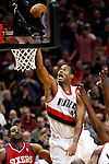 12/26/11--Trail Blazers center Marcus Canby lays the ball in the basket over 76ers defense in the home-opener at the Rose Garden...Photo by Jaime Valdez. ........................................