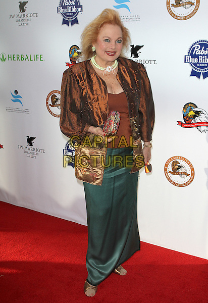 Carrol Connors.2011 Eagle & Badge Foundation Gala Held at The JW Marriott Los Angeles at L.A. LIVE, Los Angeles, California, USA..August 30th, 2011.full length skirt jacket brown velvet.CAP/ADM/KB.©Kevan Brooks/AdMedia/Capital Pictures.