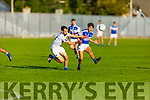 Kerins O'Rahilly's Conor Hayes about to convert his effort under pressure from Templenoe's Tom Spillane in the Senior Club Football championship.