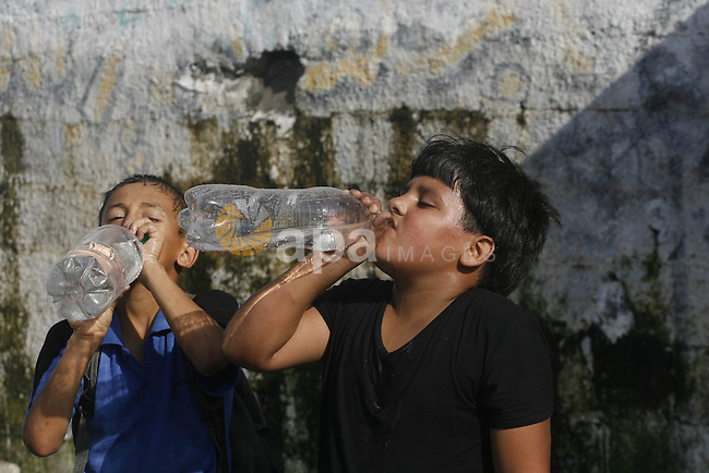 Palestinian students drink potable water at a water purification station, in Rafah refugee camp in the southern of Gaza Strip, on September 08. 2012. Photo by Eyad Al Baba
