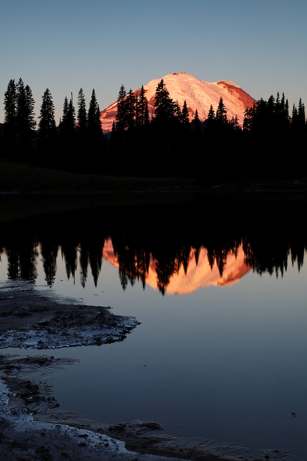 Mount Rainier reflected in Tipsoo Lake during a calm sunrise, Mount Rainier National Park, Washington, USA