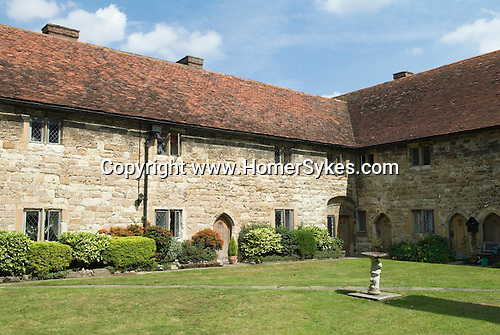 Cobham Kent. UK. The Alms Houses called The New College of Cobham.   Charles Dickens used the pub the Leather Bottle in this Kentish village and incorporated village life as seen by him here in many of his novels.