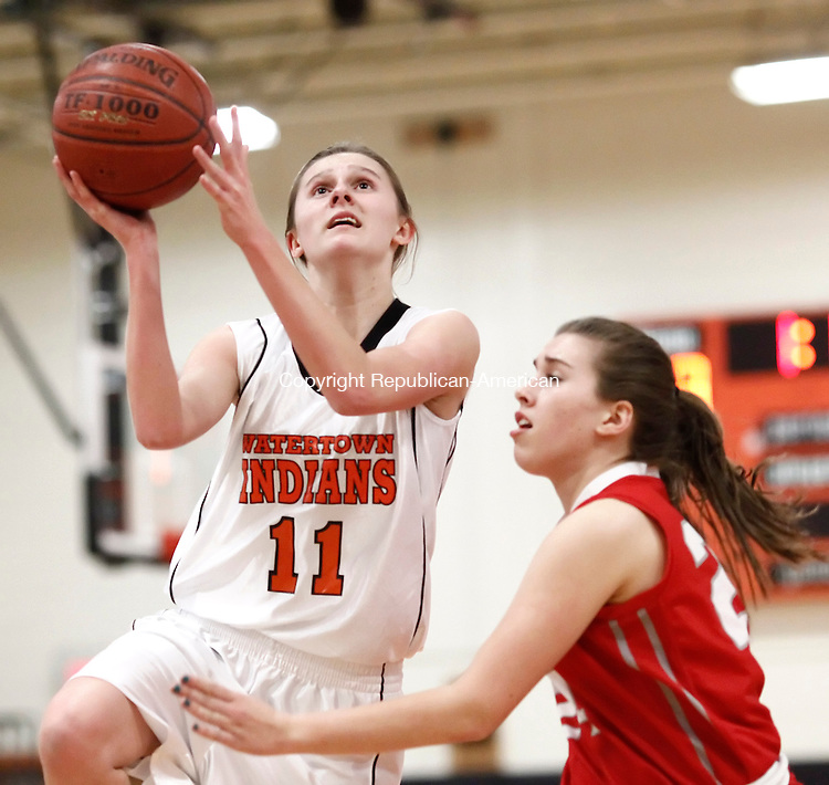 Watertown, CT- 14 February 2013-021413CM08- Watertown's Megan Perrin goes in for the layup as Wolcott's Madison Hanlon defends during their NVL matchup Thursday night in Watertown.   Christopher Massa Republican-American