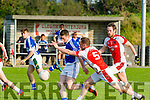 Conor O'Sullivan, Rathmore attempts to block the ball from Shannon Rangers Ambrose Lanigan when the met in Tarbert last Saturday evening