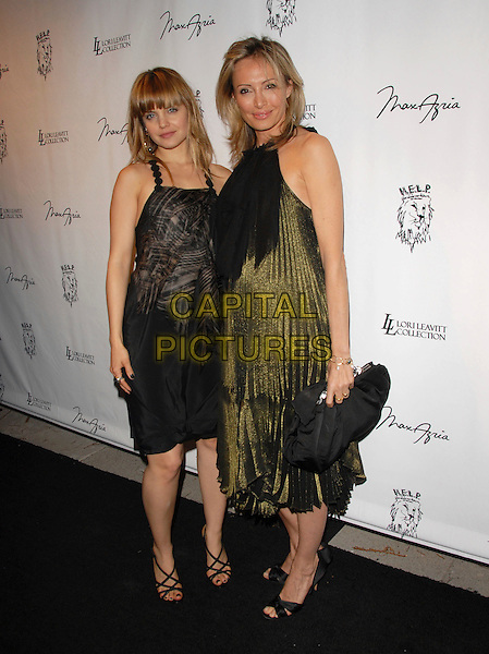 MENA SUVARI & LUBOV AZRIA .Attends The Launch Party for The Help Malawi Foundation held at Max Azria in Hollywood, California, USA..April 19th, 2007.full length black sleeveless green shiny shimmer dress bag purse pattern pleated.CAP/DVS.©Debbie VanStory/Capital Pictures