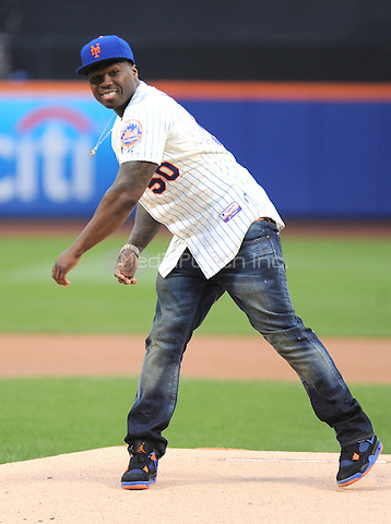 "New York, NY- May 27:  Curtis ""50 Cent"" Jackson throws out the first pitch at Citi Field extremely wild and then laughs it off as he walks off the field  on May 27, 2014 at Citi-Field in Flushing, New York. Credit: John Palmer/MediaPunch"