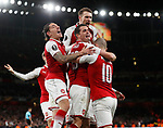 Alexandre Lacazette of Arsenal is mobbed as Arsenal celebrate the first goal during the Europa League Semi Final 1st Leg, match at the Emirates Stadium, London. Picture date: 26th April 2018. Picture credit should read: David Klein/Sportimage