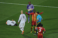 Jonathan Mensah of Ghana tries to explain himself to referee Viktor Kassai after he brought down Clint Dempsey of USA. Ghana defeated the USA 2-1 in overtime in the 2010 FIFA World Cup at Royal Bafokeng Stadium in Rustenburg, South Africa on June 26, 2010.