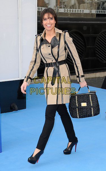 "CHRISTINE BLEAKLEY .At ""A Turtle's Tale: Sammy's Adventures 3D"" UK Premiere, BFI Southbank,  London, England, UK, March 20th 2011..full  length beige black leather belt trench coat bag shoes booties shooboots  jeans christian louboutin handbag  .CAP/CAN.©Can Nguyen/Capital Pictures."