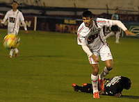 TUNJA -COLOMBIA, 31-01-2014. Maximiliano Brito (Izq) de Patriotas FC disputa el balón con un jugador del Once Caldas durante partido válido por la fecha 2 de la Liga Postobón I 2014 realizado en el estadio La Independencia en Tunja./ Maximiliano Brito (L) of Patriotas FC struggles the ball with a player of Once Caldas during match valid for the 2nd date of Postobon  League I 2014 at La Libertad stadium in Tunja. Photo: VizzorImage/Jose Miguel Palencia/STR