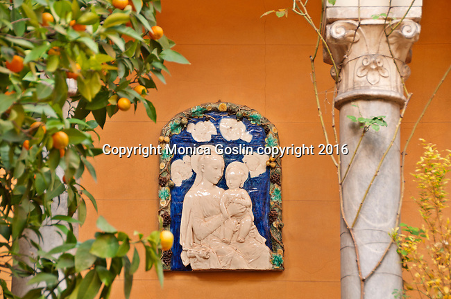 Gardens at the Sorolla Museum with a plaque of the Virgin Mary in Madrid, Spain