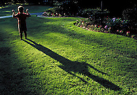 Dramatic shadow of a boy with his arms raised. May not be used in an elementary school dictionary.