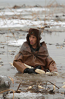 A Chinese farmer braves sub-zero temperatures to harvest lotus roots at a frozen pond at a lotus root farm on March 8, 2010 in Beijing, China. Lotus root, a popular Chinese cuisine, also symbolises good luck and sweet love in Chinese tradition.